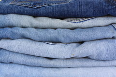Stack of blue jeans. Different shades of blue jeans stacked Royalty Free Stock Photography