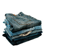 Stack of blue jeans. 5 pcs jeans on stacking with white background Royalty Free Stock Photo