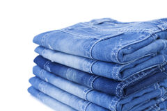 Stack of blue jeans. Isolated on white background royalty free stock photography