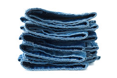 Stack of blue jeans. On white background stock images