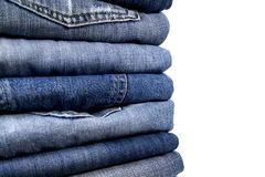 Stack of blue jeans. Over white Royalty Free Stock Photos