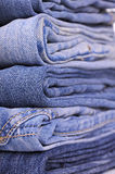 Stack of blue jeans. Blue jeans stacked closeup, focus on jeans corner Royalty Free Stock Photos