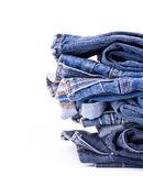 Stack of Blue Jeans. Isolated over white Royalty Free Stock Photos