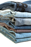 Stack of blue jeans. Isolated on white royalty free stock photo