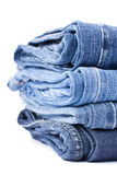 Stack of Blue Jeans. Isolated over white royalty free stock photo
