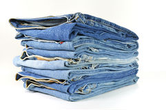Stack of blue jeans Stock Photos