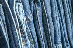 Stack of blue jeans as background royalty free stock image