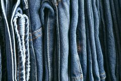 Stack of blue jeans as background royalty free stock images