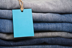 Stack of blue jeans as a background or texture Stock Image
