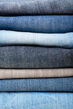 Stack of blue jeans background Royalty Free Stock Image