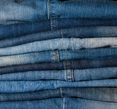 Stack of blue jeans background Stock Photo