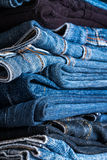 Stack of blue jeans. Background, Close up stock images