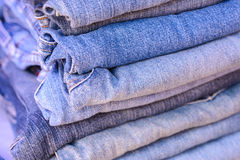 Stack of blue jeans background. Stock Photos