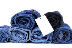 Stack of blue jeans and a blank card Stock Photo