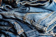 Stack of blue jeans closeup Stock Photos