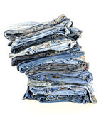 Stack of blue jeans isolate Royalty Free Stock Photos