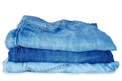 Stack of blue jeans outerwear. Stock Photos