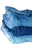 Stack of blue jeans outerwear. Royalty Free Stock Images