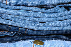Stack of blue jeans outerwear. Stock Images