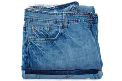Stack of blue jeans outerwear. Royalty Free Stock Photos