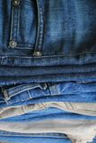 Stack of blue jeans stock images