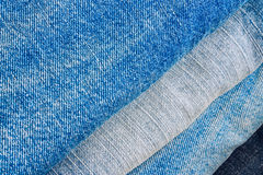 Stack of blue jeans trousers as background Royalty Free Stock Images