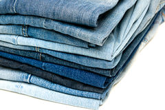 Stack of blue jeans on white Stock Photo