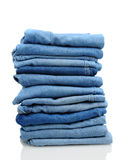 Stack of Blue Jeans on White Stock Photos