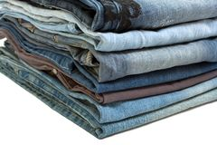 Stack of blue jeans on white Royalty Free Stock Photos