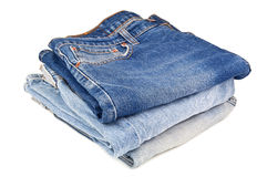 Stack of blue jeans. On white background Royalty Free Stock Image