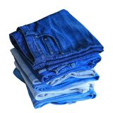 Stack of blue jeans stock photo