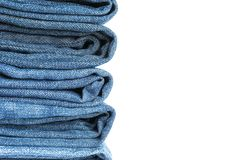 Stack of blue jeans on white background royalty free stock image