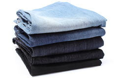 Stack of blue jeans on white background Royalty Free Stock Photography