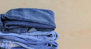 Stack of blue jeans royalty free stock images