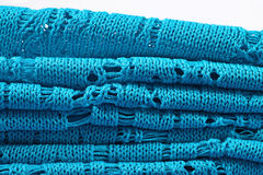 Stack of blue knitted closeup Stock Photos