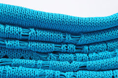 Stack of blue knitted closeup Royalty Free Stock Images