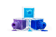 Stack of blue nail polish isolated on white background royalty free stock images