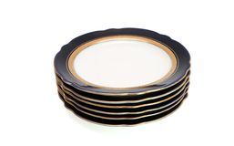 Stack of blue plates with golden rim Royalty Free Stock Images