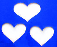 Stack of blue torn paper in heart shape symbol over white background Royalty Free Stock Photo