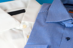 Stack of blue and white shirt closeup Royalty Free Stock Images