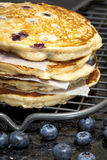 Stack of Blueberry Pancakes Cooling on Wire Rack Stock Photo