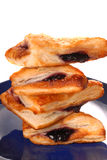 Stack of blueberry turnovers on a blue plate Stock Images