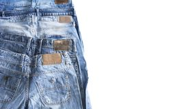 Stack bluejeans on isolated white background royalty free stock photo