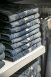 Stack of bluejeans. A stack pf blue jean in shop stock images