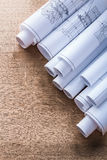 Stack of blueprint rolls on wooden oaken board. Maintenance concept Royalty Free Stock Photography