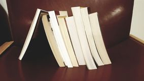Stack of Book Leaning on a Single Book stock photo