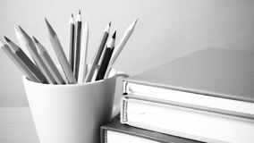 Stack of book with pencil black and white color tone style royalty free stock photo