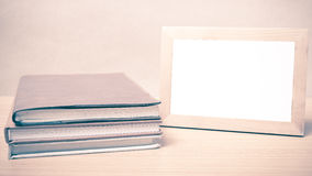 Stack of book and photo frame vintage style stock image