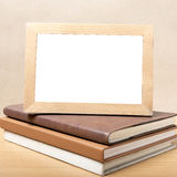 Stack of book and photo frame Royalty Free Stock Image