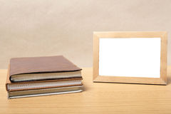Stack of book and photo frame Royalty Free Stock Photo